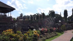 4k Beautiful Bali temple panning Kerta Gosa with garden building and sculptures Stock Footage