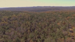 Aerial footage over Missouri forest area in early fall Stock Footage