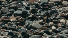 Close Up: Breaking waves on a rocky beach in Nizza. Stock Footage