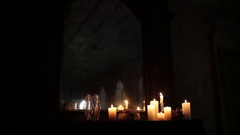Composition of candles on a black piano near a mirror Stock Footage