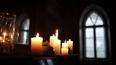 On the black piano in the old Gothic castle lit candles Stock Footage