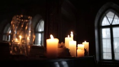 Composition of candles near a mirror. Candles close-up against the window Stock Footage