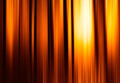 Vertical orange motion blur curtains with glow background Stock Illustration