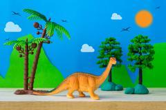 Brachiosaurus dinosaur toy model on wild models background Stock Photos