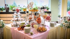 Candy bar angels fruits glasses plates sweets Stock Footage
