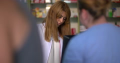 Young attracting female pharmacist working at pharmacy Stock Footage