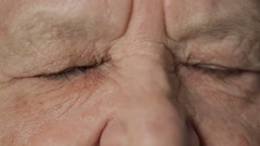 Eyes of old woman look at camera Stock Footage