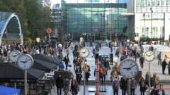 Office Workers Streaming Out of Canary Wharf Tube Station Stock Footage