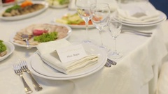 Wedding table full of delicious food and little cards with guests names Stock Footage