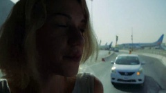 Young girl traveling in airport with a bus to the plane Stock Footage