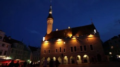 A crowd of tourists visit Town hall square in the Old city in Tallinn, Estonia Stock Footage