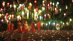 Buddhist monks walk among candles during Loy Kratong Celebration in Chiang Mai Stock Footage