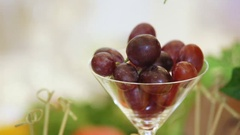 Grapes in a glass on table Stock Footage