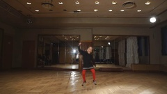 Little girl dancing in red tights Stock Footage