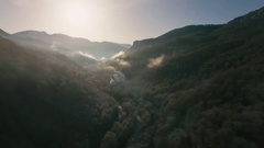 The Copter Flies Over the Gorge at the Bottom Flows the River in Front of Stock Footage