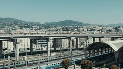 Train station in Nizza with a highway and the city in the back Stock Footage