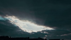 Sunlight gets suppressed by dark storm clouds Stock Footage