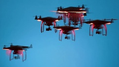 Swarm of energetic Black Drones maneuvering ominously Stock Footage