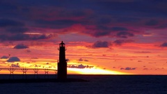 Amazing red sky predawn scenic of lighthouse Stock Footage