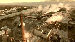 Aerial flyover of scenic industrial zone with smokestacks, early morning Stock Footage
