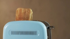 Two Loaves of Bread Jumping Out of an Electric Toaster Stock Footage
