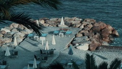 Sun loungers on the coast of Nizza Stock Footage
