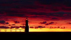 Amazing red sky predawn time lapse of lighthouse Stock Footage