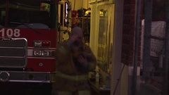 Fireman puts on oxygen mask at firehouse. Stock Footage