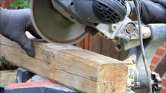Man using electric saw, cutting wood, sound Stock Footage