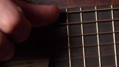 Guitarist hand touching strings. 4K macro video Stock Footage