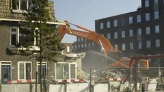 Excavator demolishes house - 4K Stock Footage