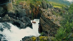 Small beautiful waterfall from top view. Finnmark, Norway. Summer 2016 Stock Footage