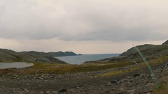 Fjord and ocean by the road. Finnmark, Norway, Nordkapp. Summer 2016 Stock Footage