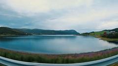 Small village by blue beautiful fjord,field,meadow.Finnmark, Norway. Summer 2016 Stock Footage