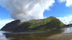 Green mountains,blue fjord,ocean.Driving on Lofoten islands,Norway 2016. HD 1080 Stock Footage