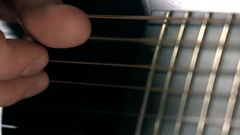 Man's hand touching strings. 4K macro video Stock Footage