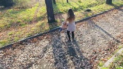 Mother turns baby outdoor. Top view from dron helicopter. Autumn Stock Footage