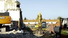Excavator segregates debris - 4K Stock Footage
