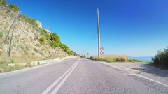 POV vehicle car drive mediterranean coastline travel road clear blue sky sunny Stock Footage