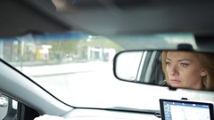 A woman driving a car. attentive girl rides around city Stock Footage