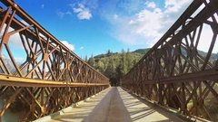 POV vehicle drive car travel old metal bridge sunlight flashing narrow road Stock Footage