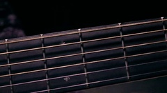 Male hand touching strings on fretboard. Music performance. 4K macro video Stock Footage