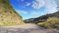 Point of view vehicle drive car beautiful nature narrow road blue sky sunny POV Stock Footage