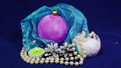 New Year's balls and tinsel on a blue background Stock Footage