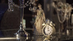 Antique Christmas ornament of a clock with other Xmas decorations. Ornament by Stock Footage