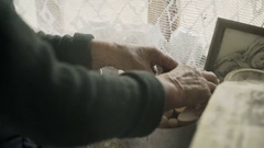 Poor old grandmother takes eggs at the window Stock Footage