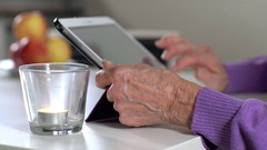 Pensioner working with tablet Stock Footage