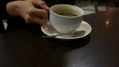 Drink large cup of coffee, time lapse shot. Woman hand hold white mug Stock Footage