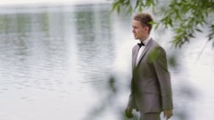 Groom coming up to bride and kissing her Stock Footage
