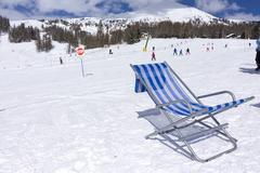 Close-up of deck chair on a ski slope Stock Photos